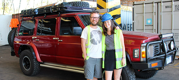 Kev and Emma stand beside the 4x4 after collecting it in Buenos Aires.